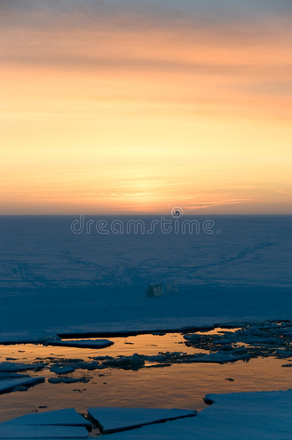 Sunset in the winter at the polar circle royalty free stock photography