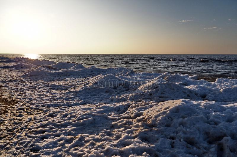 Sunset and winter snow observing on sea royalty free stock photos