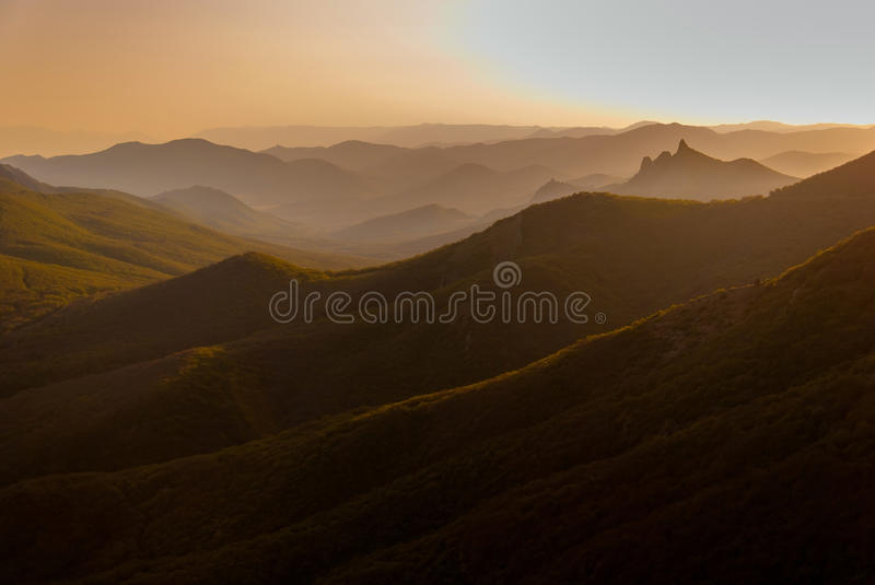 Sunset in the wooded mountains stock photos