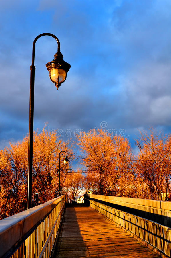 Sunset And Wooden Bridge Stock Images