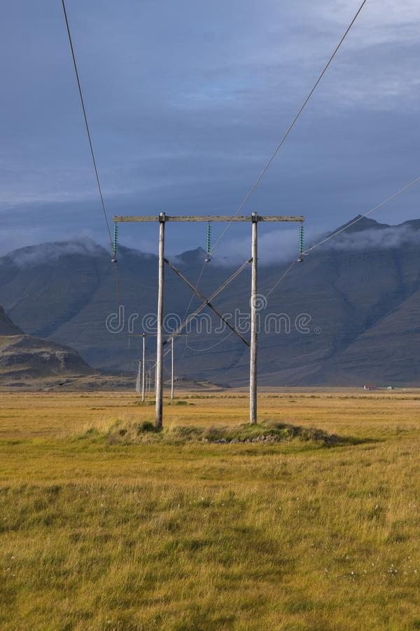 Sunset and power lines in Icelandic landscape royalty free stock photos