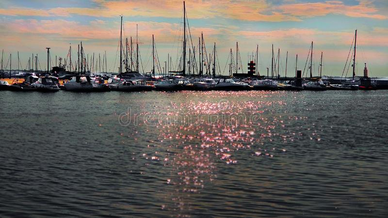 Sunset in Yachting Harbor Yachting club boat seascape evening in port Baltic Sea Estonia Tallinn sunlight  on water reflection bac. Kground summer travelling royalty free stock photos