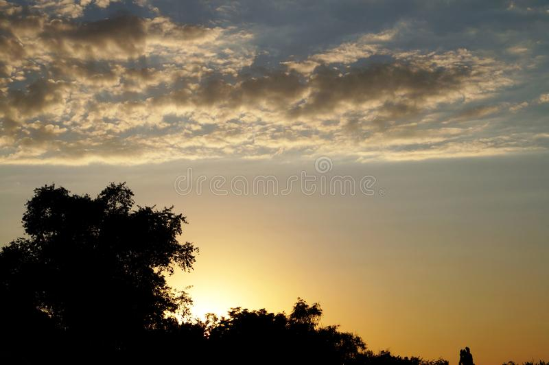 Sunset. Yellow sunset. Golden sunset. Sky. Heavenly colors. Beauty of nature. The sky in gentle tones. Nature draws. Sunset in the sky. Soltse comes. Clouds stock photos