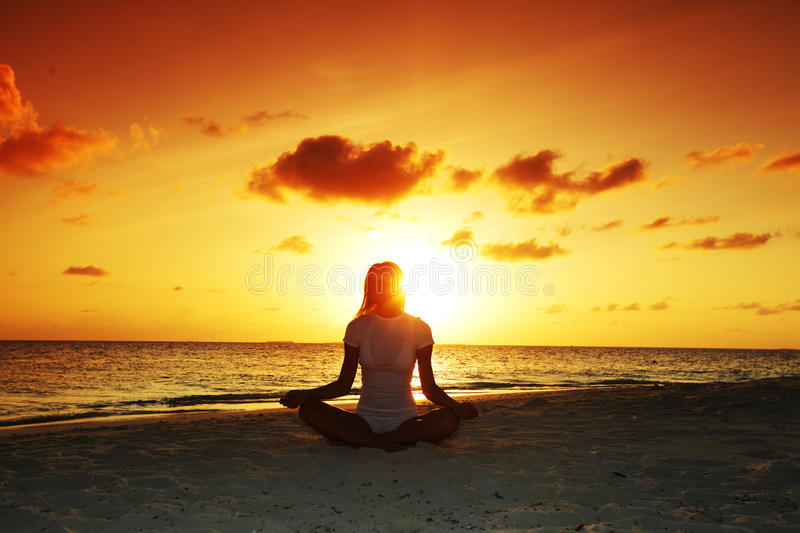 Download Sunset yoga woman stock photo. Image of ocean, person - 21724458