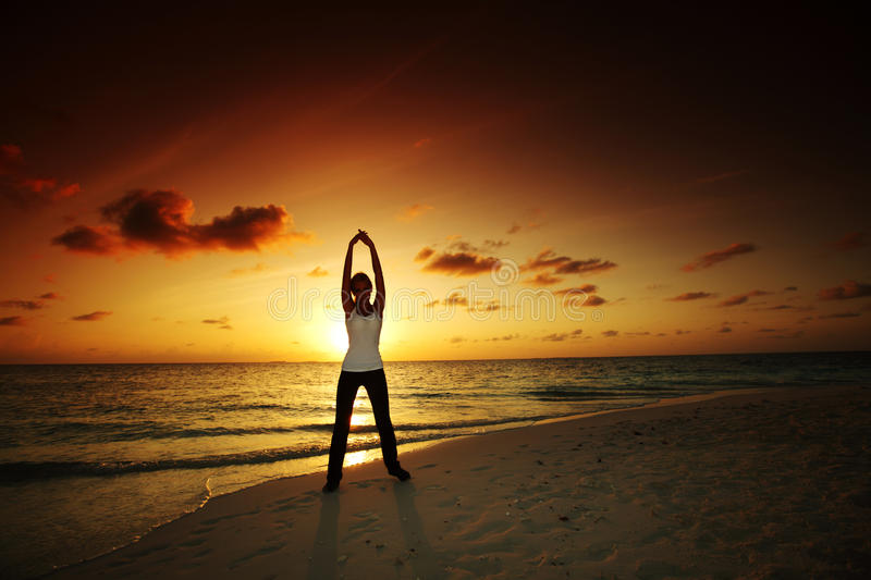 Download Sunset yoga woman stock photo. Image of outdoor, coast - 21930340