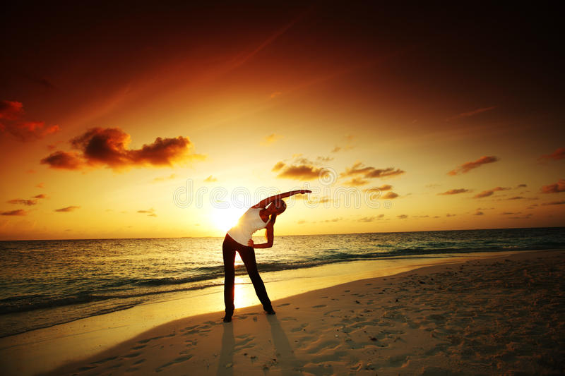 Download Sunset yoga woman stock image. Image of adult, exercise - 23354979