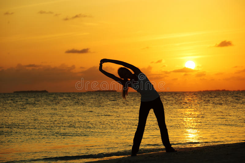 Download Sunset yoga woman stock photo. Image of lotus, lifestyle - 23354984