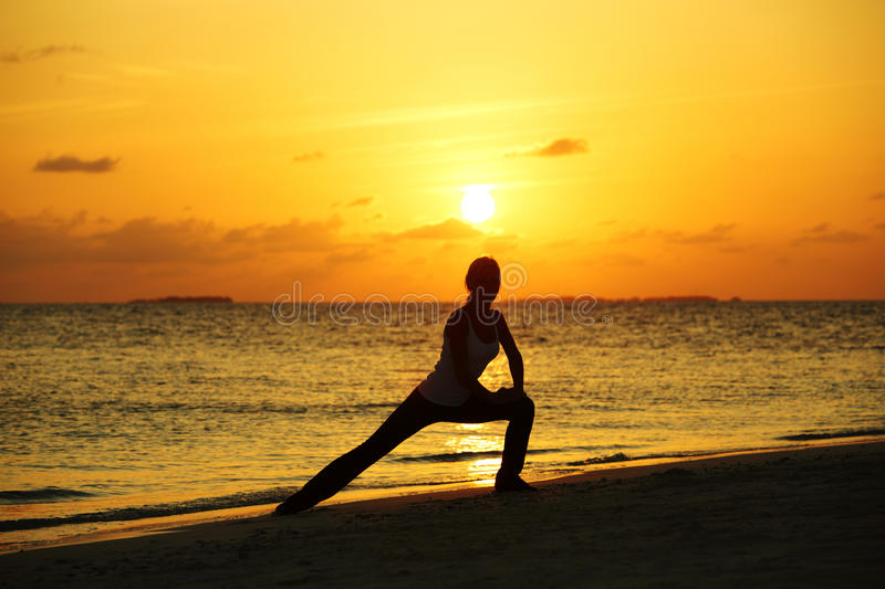 Download Sunset yoga woman stock photo. Image of lifestyle, ocean - 23354990