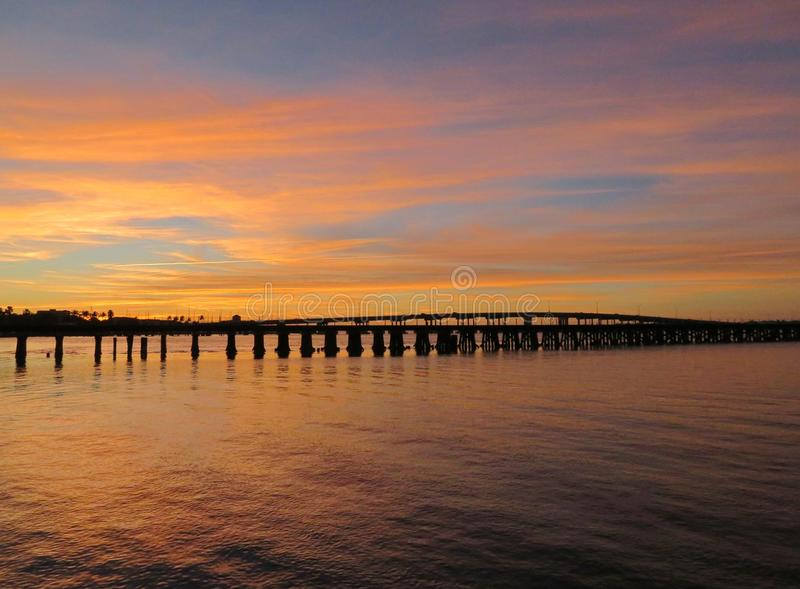 Sunseting over the Manatee River. Sunset over the Bradenton Bridge over the Manatee River in Tampa Florida royalty free stock photo