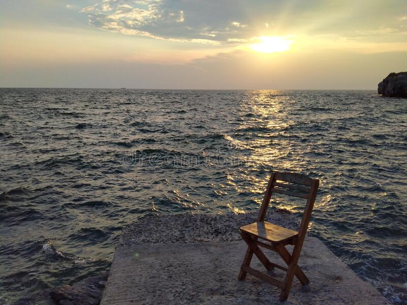Sunsets aloneness in the sea stock photography