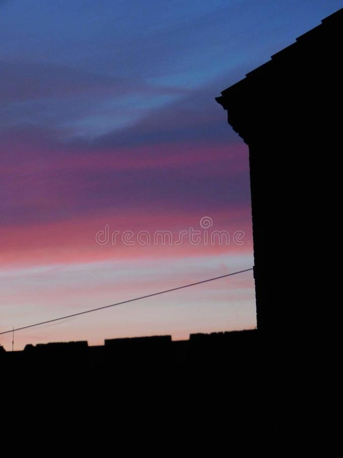 Home sunsets 1. Sunsets 1. sunsets 1, , , , blue, sky, , , , , house, fence royalty free stock photography