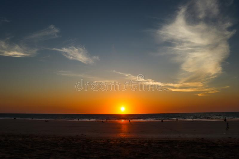 Sunsets over a vast ocean stock images