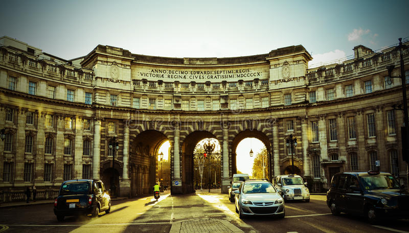 Sunsets over Admiralty Arch. A picture taken as the sunsets over Admiralty Arch (near Trafalgar Square) heading towards Buckingham Palace stock photo