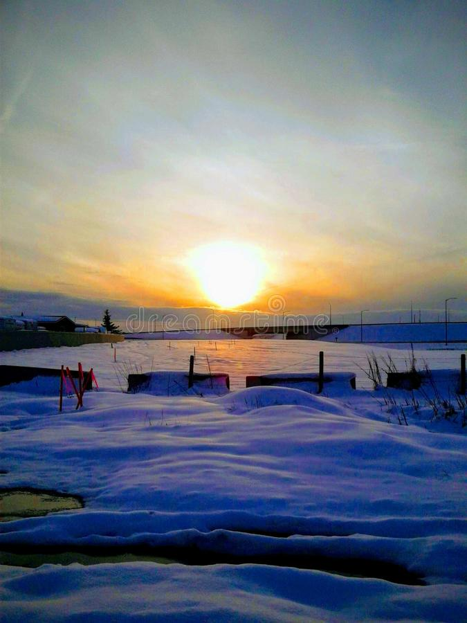 Sunsetting on a cold winter evening on the outskirts of Calgary Alberta Canada royalty free stock images