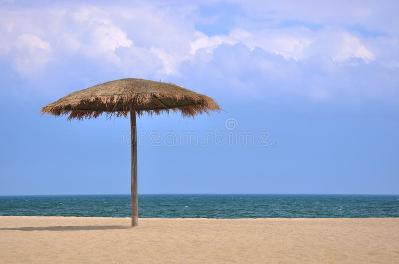 Download Sunshade On Beach With Blue Sky And White Cloud Stock Photo - Image: 20186508