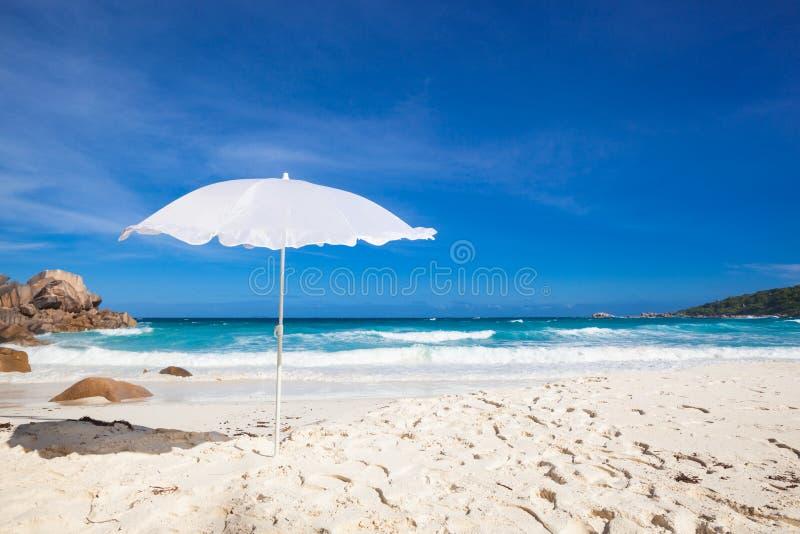 Sunshade And Rocks Royalty Free Stock Photos