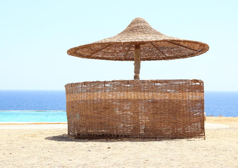 Sunshade by pool and sea royalty free stock image