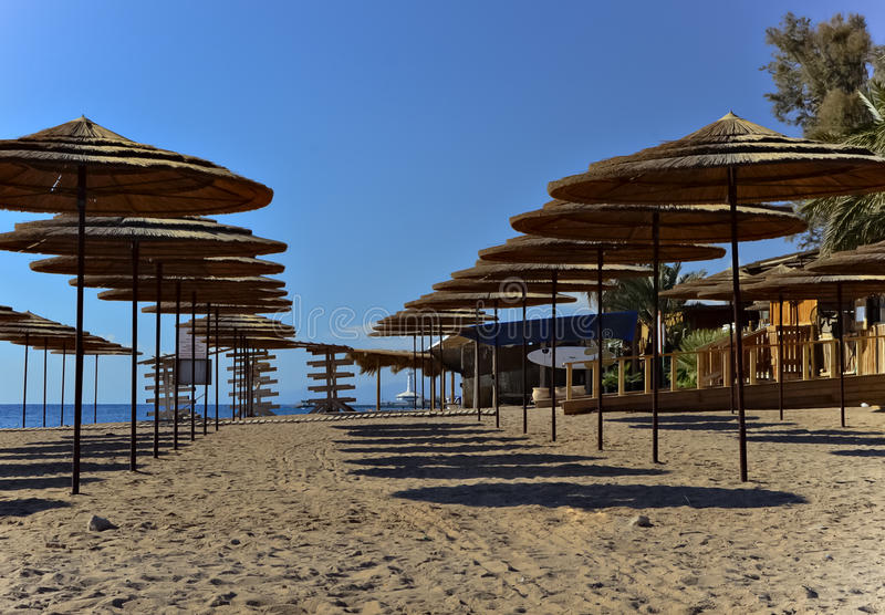 Sunshades on southern beach of Eilat. The city of Eilat is a famous city with beautiful beaches and resort hotels royalty free stock photos