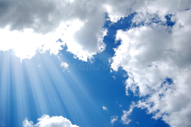 Sunshine from clouds in day. Background stock image