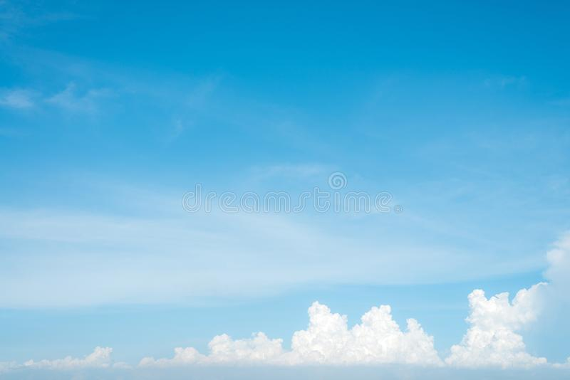 Sunshine clouds sky during morning background. Blue,white pastel heaven,soft focus lens flare sunlight. Abstract blurred cyan gradient of peaceful nature. Open royalty free stock photography