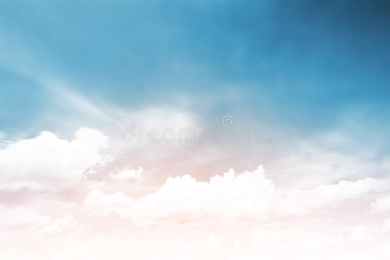 Sunshine clouds sky during morning background. Blue,white pastel heaven,soft focus lens flare sunlight. Abstract blurred cyan stock photos