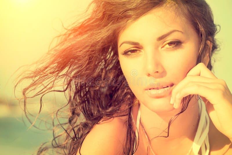 Sunshine girl on the beach royalty free stock photography