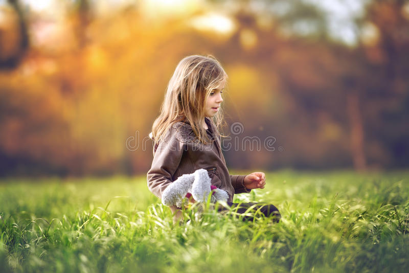 Sunshine. A little girl in a green field royalty free stock photography