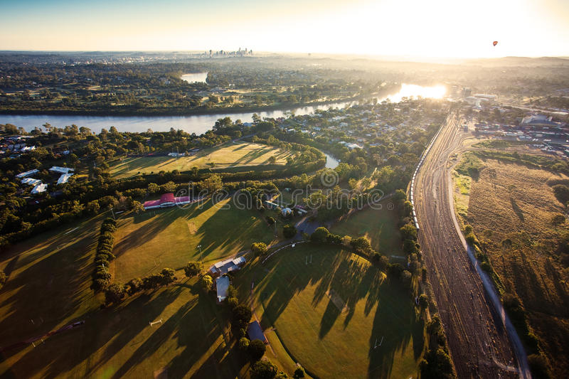 Sunshine over early morning in Brisbane from air stock photo