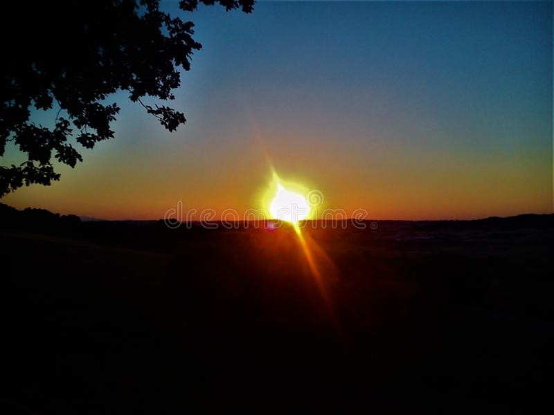 Sunshine, sunset and sunlight. Shade of colours and magic in an enchanting frame, horizon and nature, fascination and inspiration, universe and world royalty free stock image