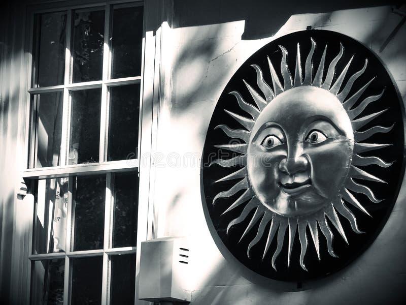 Sunshine symbol on house wall stock image