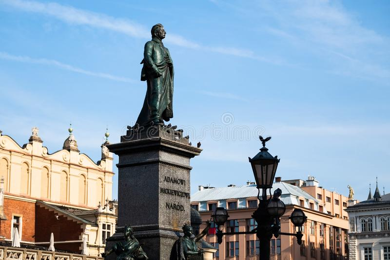 Sunshine view of monuments and ancient towers on the Krakow city central square royalty free stock photo