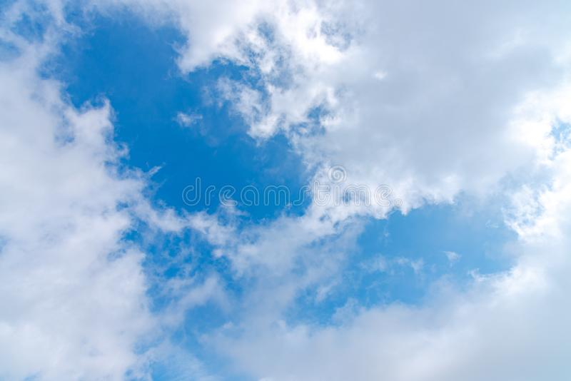 Sunshine white clouds sky during morning like a heart symbol royalty free stock photos