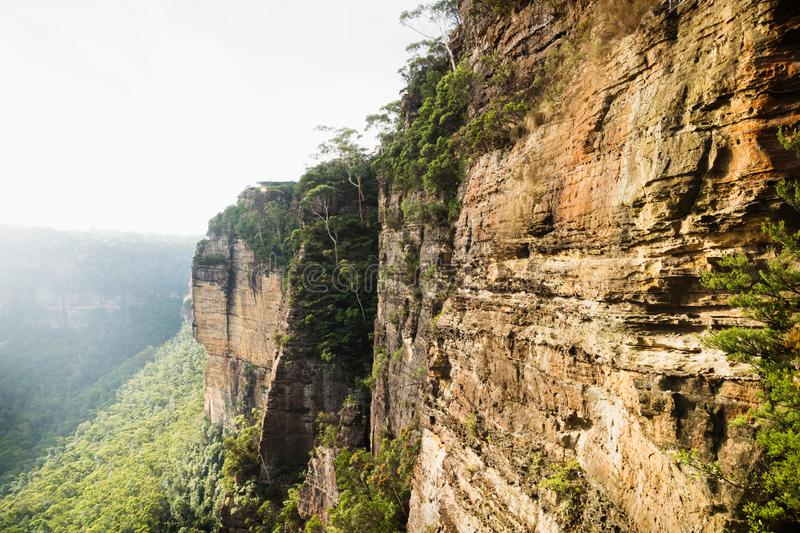Sunshined cliffs and canyons along the Three Sisters with view to Echo Point, Katoomba, New South Wales, Australia royalty free stock photography