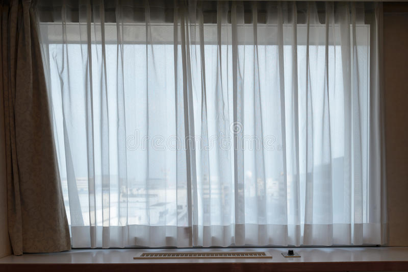 Sunshire light looking pass Translucent white fabric curtains an. D window glass fame and view outdoor background royalty free stock photography