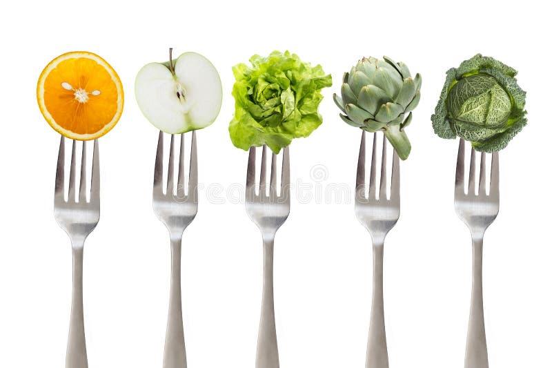 Sunt äta: gaffel för järn fem med frukt och grönsaken, på vit arkivbild