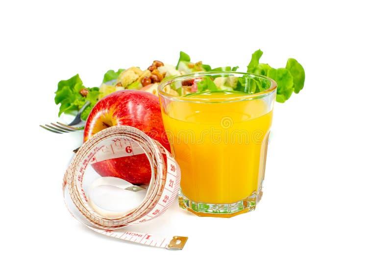 Sunt ?ta med sallad- och fruktfruktsaft royaltyfri bild
