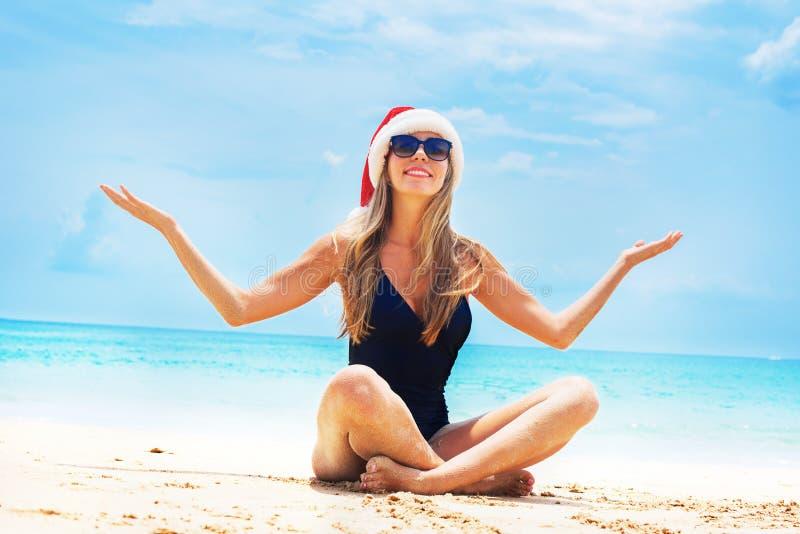 Suntan woman relaxing beach christmas santa hat stock images