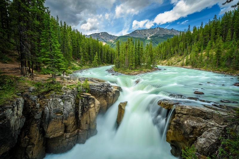 Sunwapta Falls in Jasper National Park, Canada. Upper Sunwapta Falls in Jasper National Park, Canada. The water originates from the Athabasca Glacier. Long stock photos