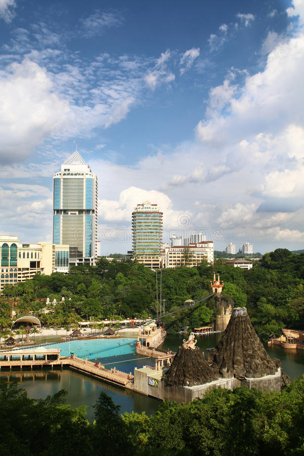 Sunway Lagoon outdoor water theme park in Malaysia - Series 2. View of Sunway Lagoon theme park with Sunway Group Headquarters. The two landmarks are built and royalty free stock photography