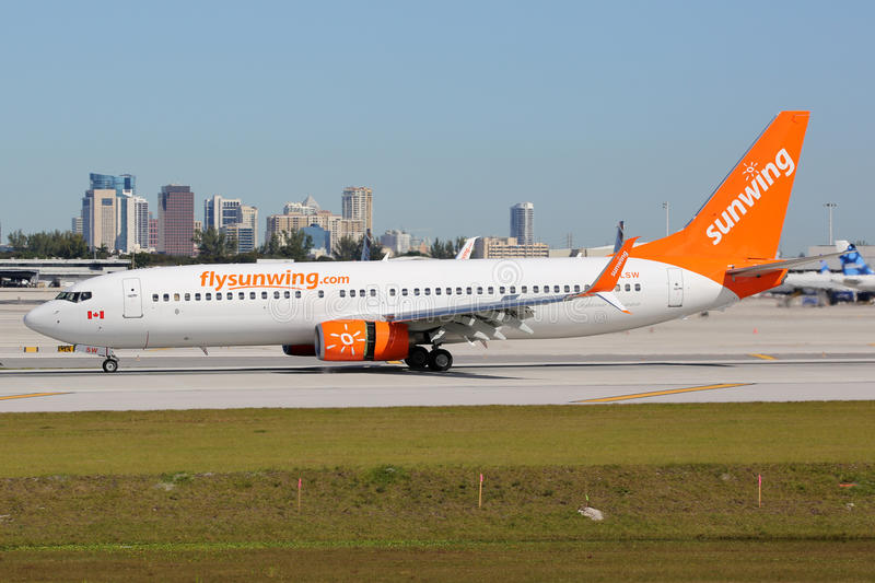 Sunwing Airlines Boeing 737-800 airplane Fort Lauderdale airport. Fort Lauderdale, United States - February 17, 2016: A Sunwing Airlines Boeing 737-800 with the stock photos