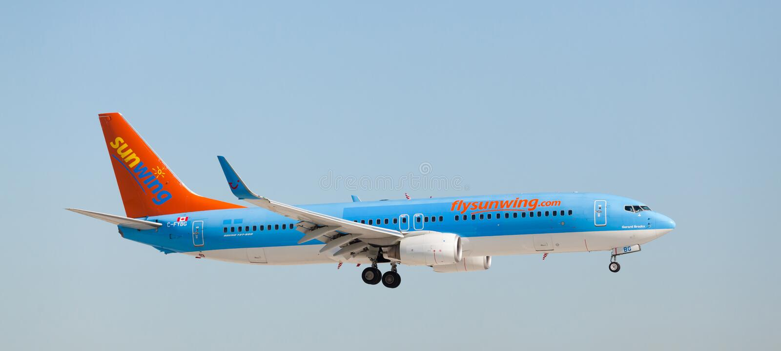 A Sunwing Airlines Boeing 737 landing stock photo