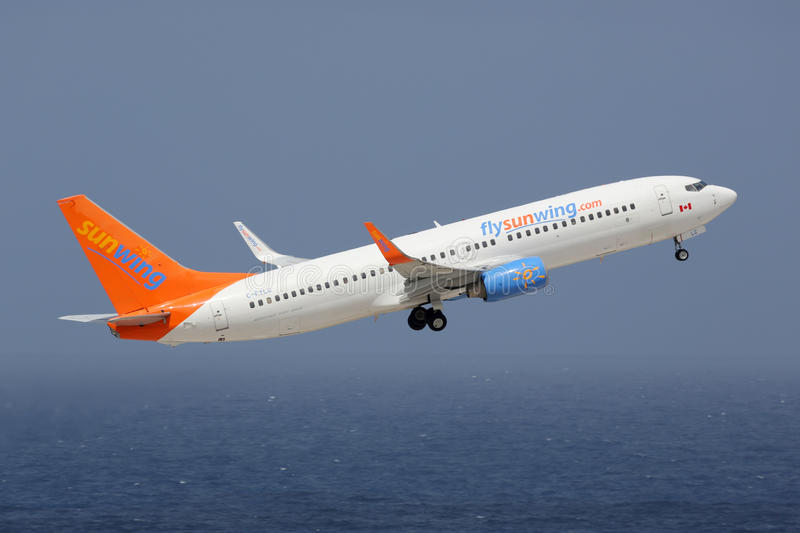 Sunwing Boeing 737-800. Curacao - February 16, 2014: A Sunwing Airlines Boeing 737-800 with the registration C-FYLC taking off from Curacao Airport. Sunwing stock images