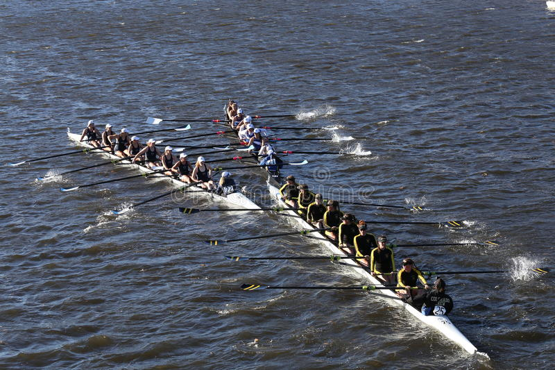 SUNY Geneseo (left) JWU Rowing (right) Colorado (bottom) races in the Head of Charles Regatta royalty free stock photography