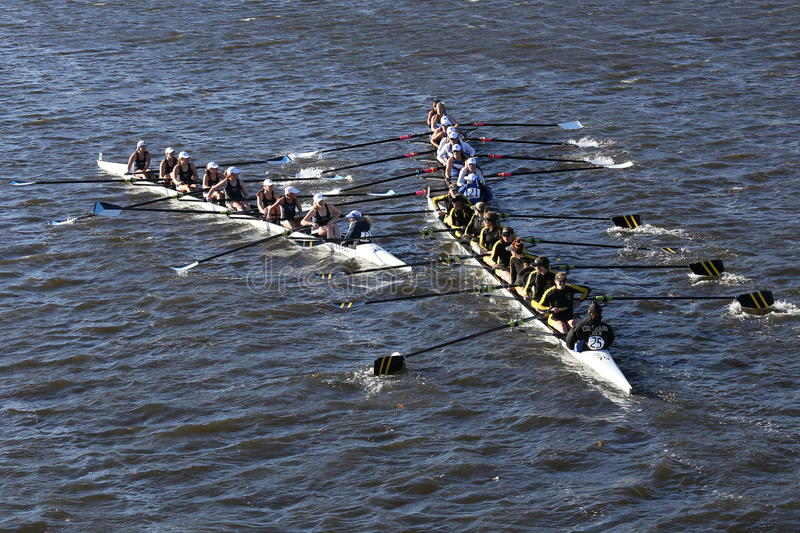 SUNY Geneseo (left) JWU Rowing (right) Colorado (bottom) races in the Head of Charles Regatta royalty free stock photo