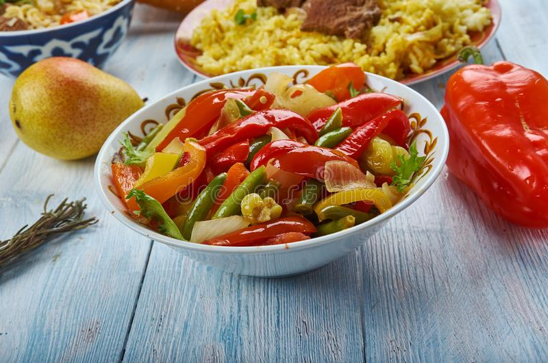 Uyghur Suoman gush siz. Suoman gush siz, delicious dish of vegetables, peppers. Uyghur cuisine, Asia Traditional assorted dishes, Top view royalty free stock photos