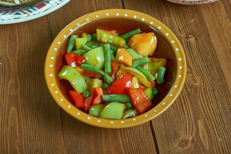 Suoman Gush Siz - Kashgar. Delicious dish of vegetables, peppers,Xinjiang cuisine , Uighur food stock images