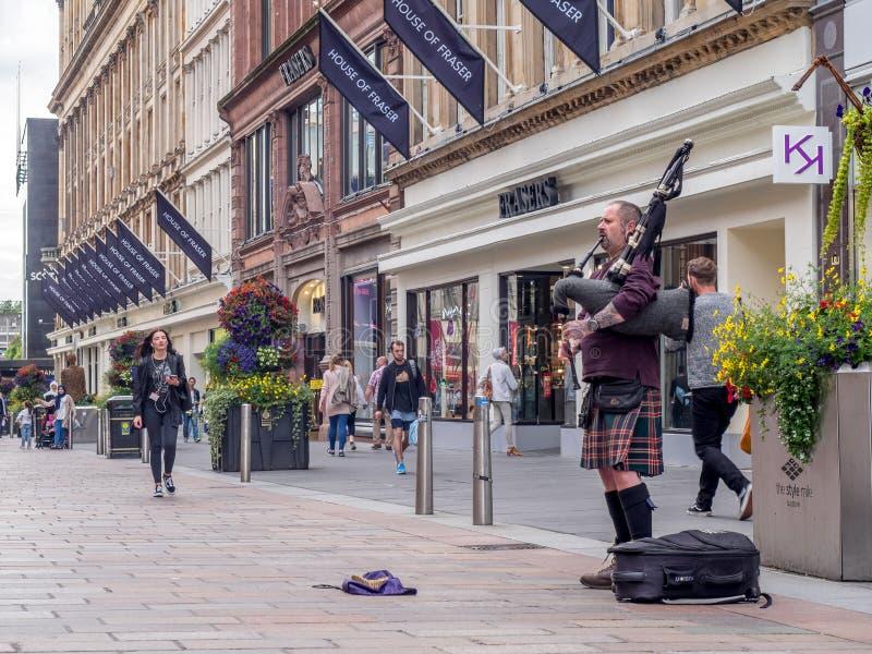 Suonatore di cornamusa, via di Buchanan, Glasgow fotografia stock libera da diritti
