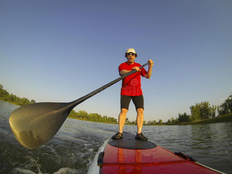 Download SUP - stand up paddling stock image. Image of stand, mature - 32978563