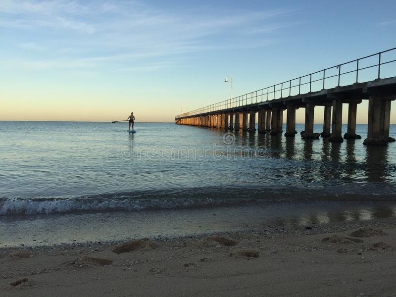 SUP at Sunrise at Dromana Beach royalty free stock photography