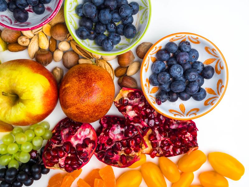 Super antioxidants. superfood. mix of fresh fruits and berries, rich with resveratrol, vitamins, raw food ingredients. nutrition royalty free stock photos